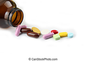 Pill of many color Beside the bottle. - The Pill of many...