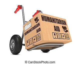Humanitarian Aid - Cardboard Box on Hand Truck. -...