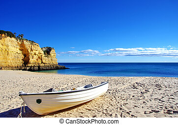 Fishing boat in the sand Algarve, Portugal