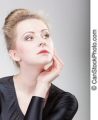 Portrait young beautiful blonde girl make up and hair bun -...