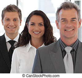 Happy Business team looking at camera - Young Happy Business...