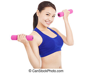 smiling woman working out with dumbbells in her hands