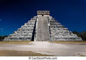 Ziggurat pyramid at Chichen Itza with two people staring at...