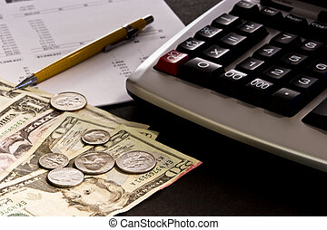 Money, calculator and financial statement