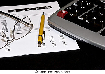 Reading financial statements - Reading glasses on top of a...