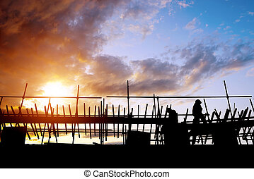 Construction workers on scaffolding - construction workers...