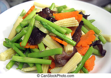 Many types of sliced vegetables in dish - Closeup Many types...