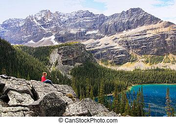 Young woman admiting Lake O'Hara, Yoho National Park, Canada...