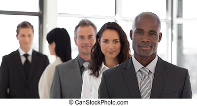 Five person Business team looking at camera and smiling -...