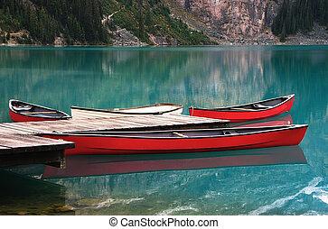 Red canoes at Lake O'Hara, Yoho National Park, Canada - Red...