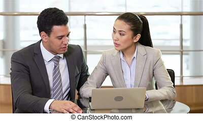 Multi-racial Team - Ethnic business team of two having a...