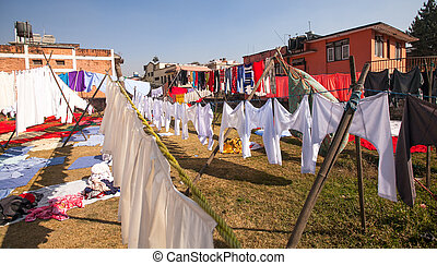 Colorful wet clothes washed in Kathmandu, Nepal.