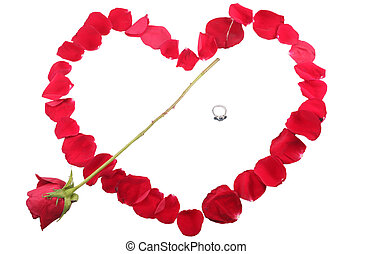beautiful heart of red rose petals with a ring and a red rose