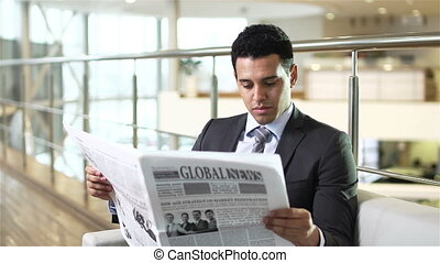 Daily Newspaper - Serious businessman reading the daily...