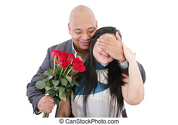Man offering a bouquet of red roses to a woman