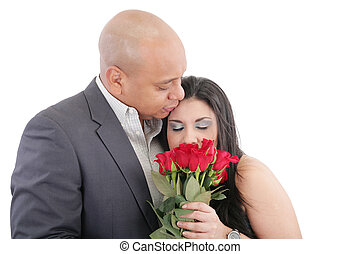 woman enjoys the smell given of a bouquet of roses. Happy couple in love. Valentines day Concept.