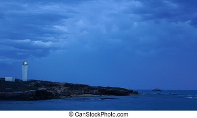 Lighthouse and storm clouds
