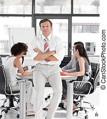 Business manager leading a team of workers - Manager leading...