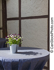 Bunch of Pansy on a table of cafe. - Pansy (Viola tricolor)....