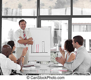 Senior Business man giving a presentation to a group of...
