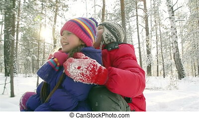 Sunny Winter Day - Healthy kids sledding on a sunny winter...