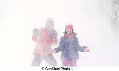 Heavy Snowfall - Kids enjoying a heavy snowfall in the...