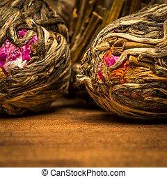 Flower tea close-up over wooden background