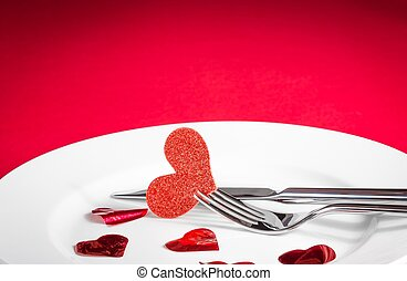 valentine day dinner on red background - decorative red...