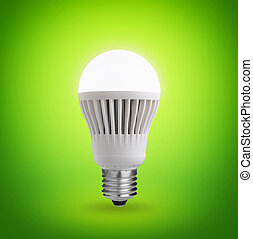 LED bulb - Glowing LED bulb on green background