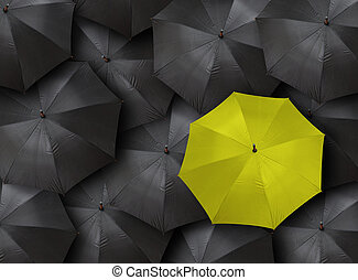 umbrellas - concept for leadership with many blacks and...