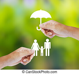 Family, insurance concept - Hand holding a paper family and...