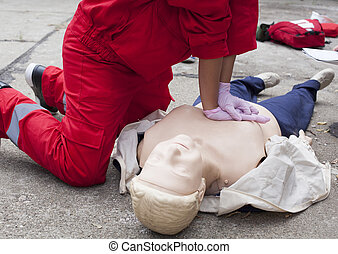 CPR training - Paramedic demonstrates CPR on dummy