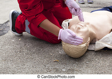 First aid - CPR practitioner examining airways on dummy