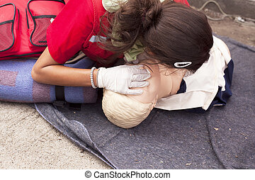 Artificial respiration - CPR practitioner examining airways...