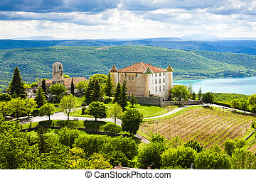 chateau and church in Aiguines and St Croix Lake at...
