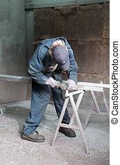 Welder B - Welder preparing metal for welding...