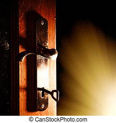 Open door with key into the dark room with light