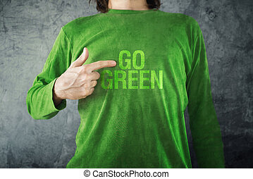 Go green. Man pointing to title printed on his shirt - Man...