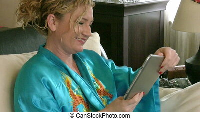 woman with touch screen tablet computer smiling to camera
