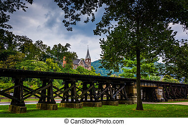 Railroad tracks and view of a church in Harpers Ferry, West...