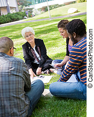 University Professor Outdoors with Students