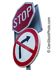 Stop - a stop road sign over a roadsign that forbid to turn...