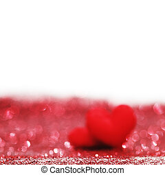 Valentines day decorative hearts on red glitter background