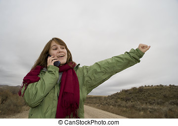 Teenage girl talking on a cell phone - Teenage girl on a...