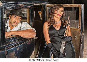 Gangsters with Shotgun in Car - Tough male and female...
