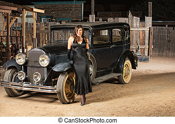 Seductive Woman Leaning on Car - Sultry woman in black next...