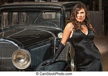 Seductive Woman by Antique Car - Seductive woman in black...