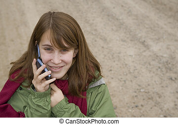 Teenage girl talking on a cell phone - Happy teenage girl on...