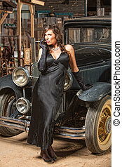 Pretty Woman Leaning on Car - Pretty woman in black with...