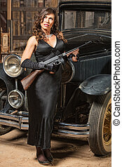 Lady with Gun Looking Away - Beautiful woman with vintage...
